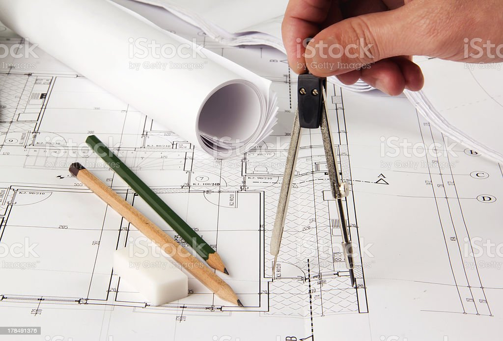 Architect making corrections on plans royalty-free stock photo