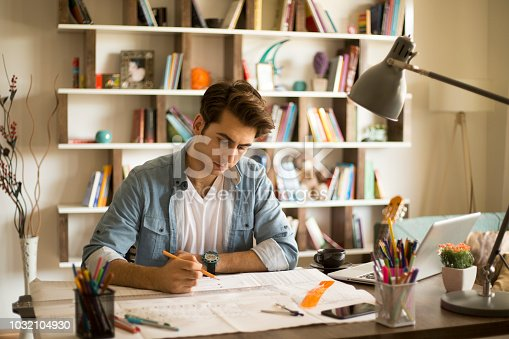 istock Architect man holding pencil working with laptop and blueprints for architectural plan, engineer sketching a construction project concept. 1032104930
