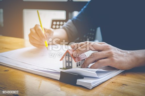 istock Architect man working with compasses and blueprints for architectural plan,engineer sketching a construction project concept. 924300922