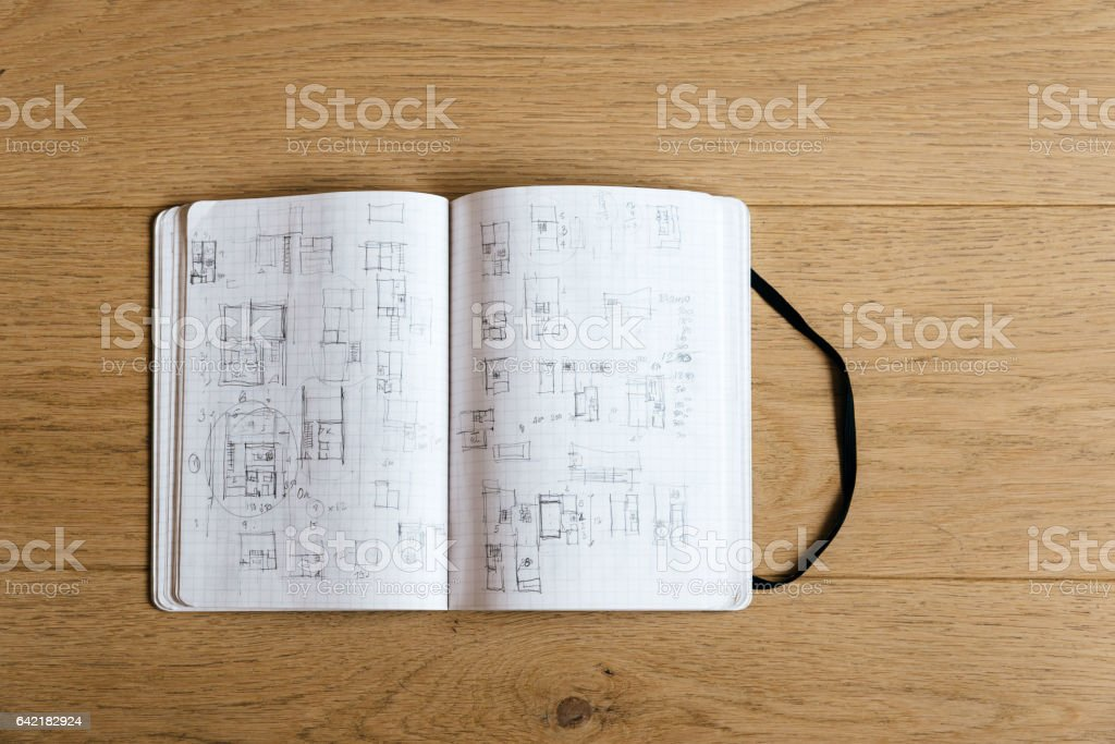 Architect notebook with drawings stock photo