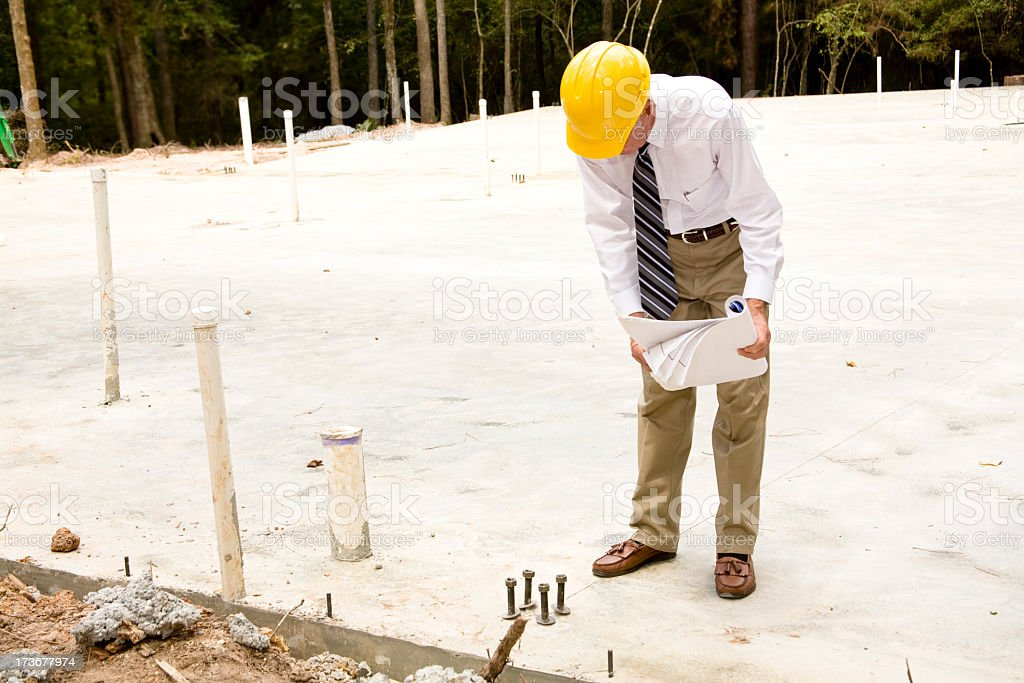 Architect or contractor on the construction site royalty-free stock photo