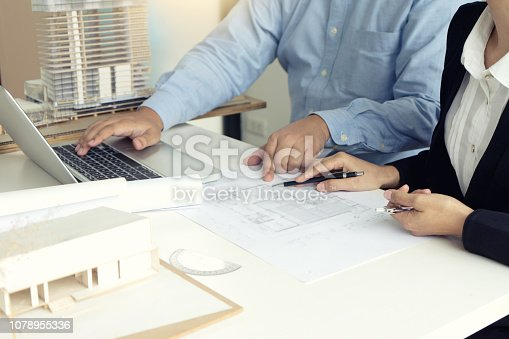 istock Architect or engineer hand on the table 1078955336