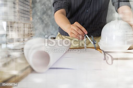 istock Architect or engineer working in office, Construction concept. 534558234