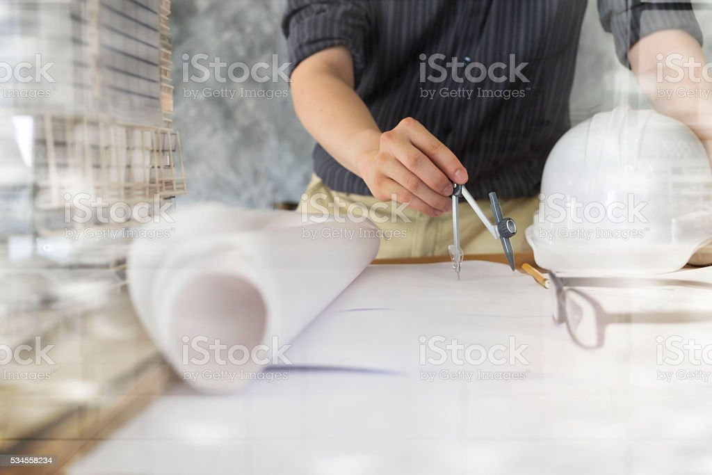 Architect or engineer working in office, Construction concept. stock photo