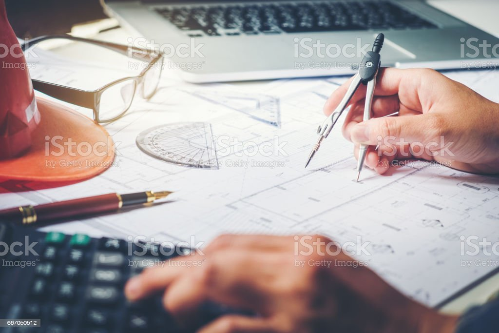 Architect or engineer working in office on blueprint architects architect or engineer working in office on blueprint architects workplace blueprints ruler malvernweather Image collections