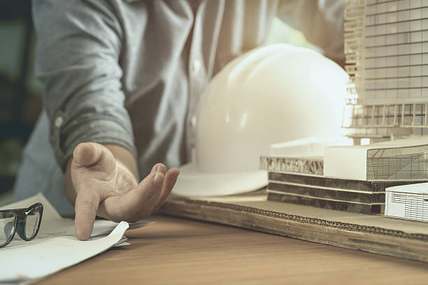 architect or engineer working in office - civil engineering stock pictures, royalty-free photos & images