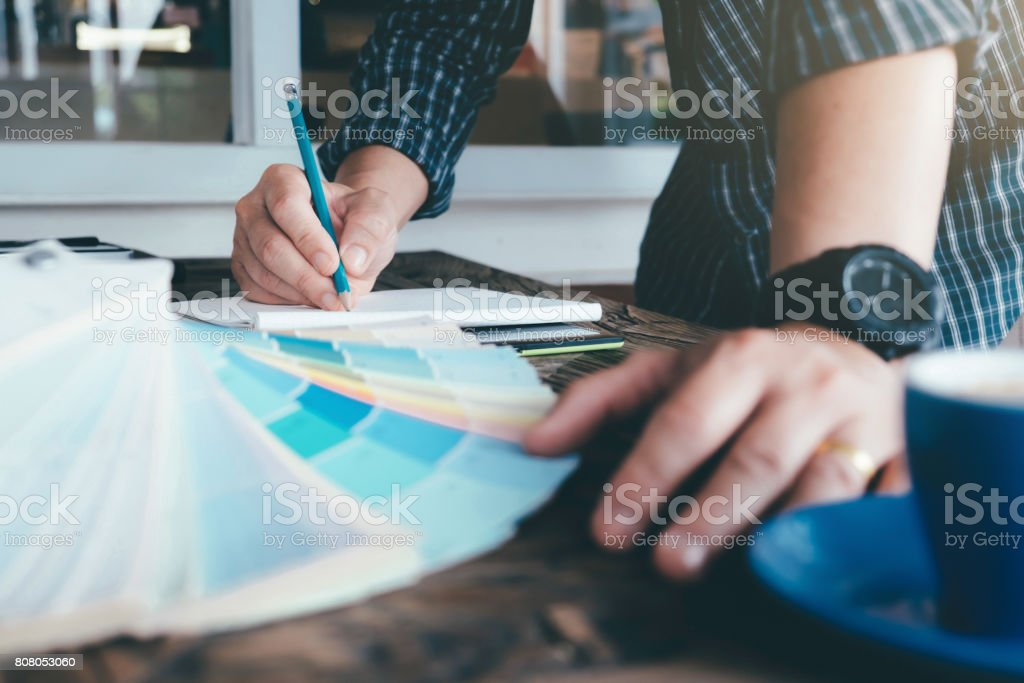 Architect or  Interior designer selects color tones for house project stock photo