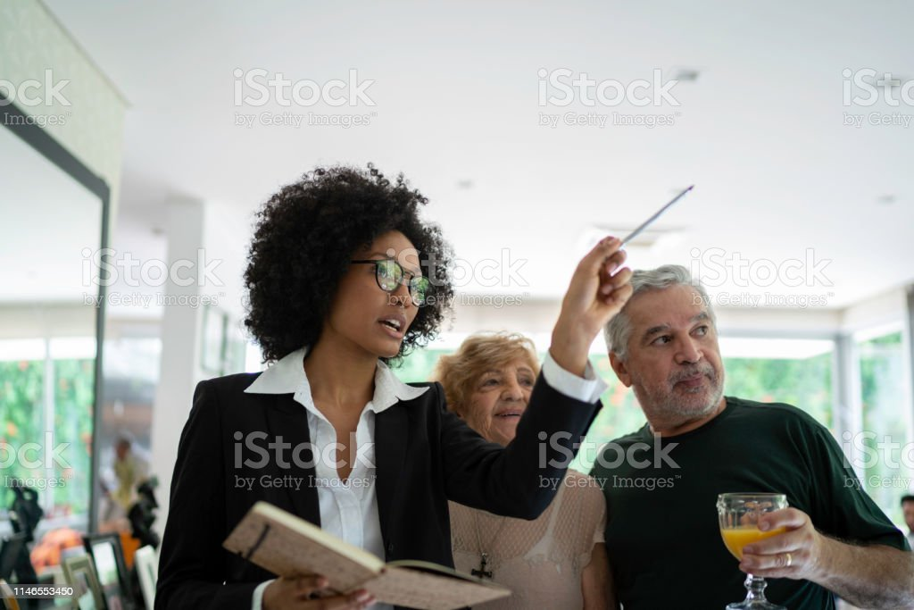 Architect or real state agency visiting a house with her clients