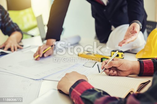 1174841541 istock photo Architect people design planning and presenting the project at the meeting 1159058772