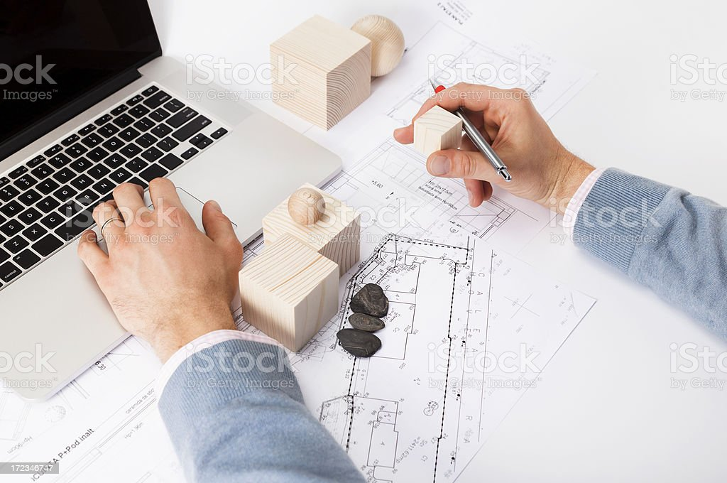 \'Architect Planning the City with Wooden Shapes. Scale Model....