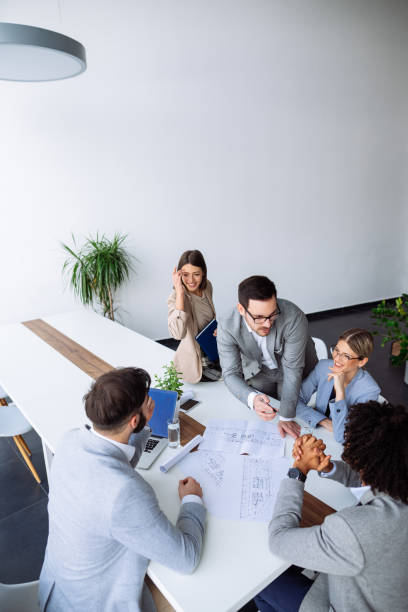 Architect presenting project plan in a meeting stock photo