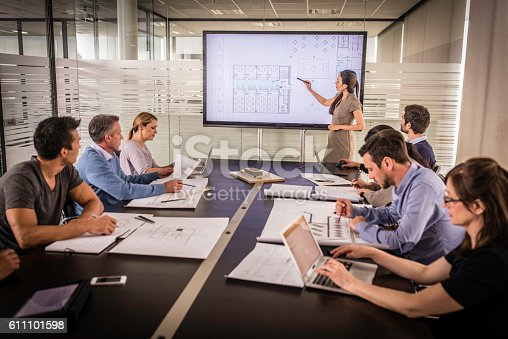 istock Architect presenting project plan 611101598