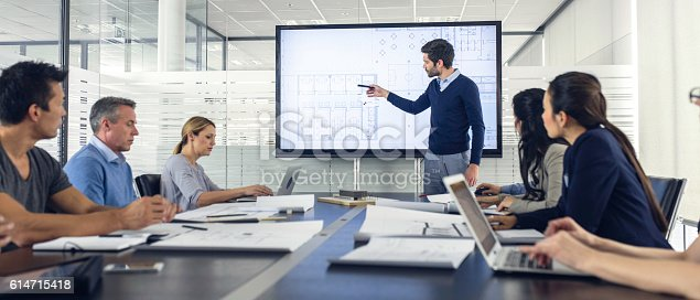 istock Architect presenting project to a group of managers 614715418