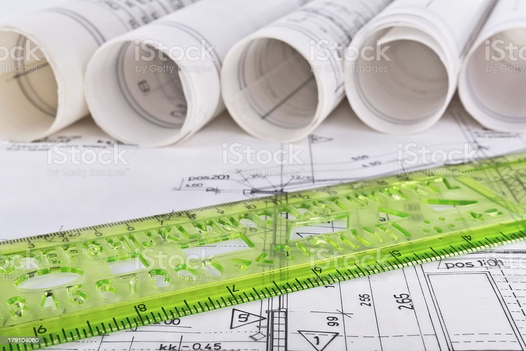 Architect rolls and plans real estate concept stock photo