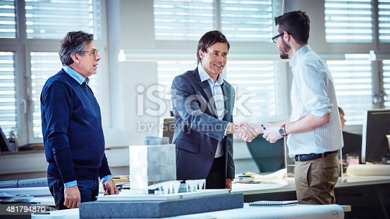 1055059750istockphoto Architect shaking hand with client 481794870