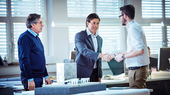 istock Architect shaking hand with client 481794870