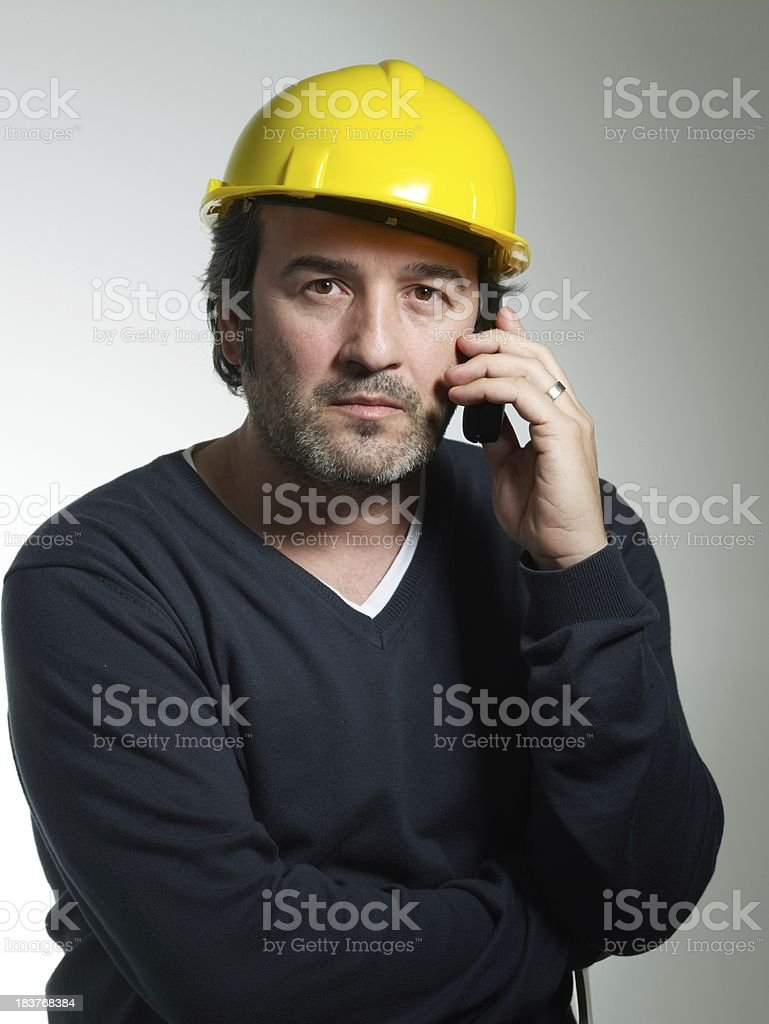 Architect speaks by phone royalty-free stock photo