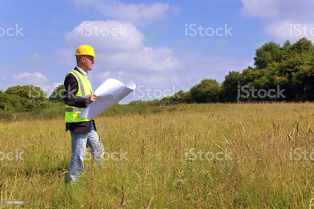 Architect surveying a new building plot stock photo