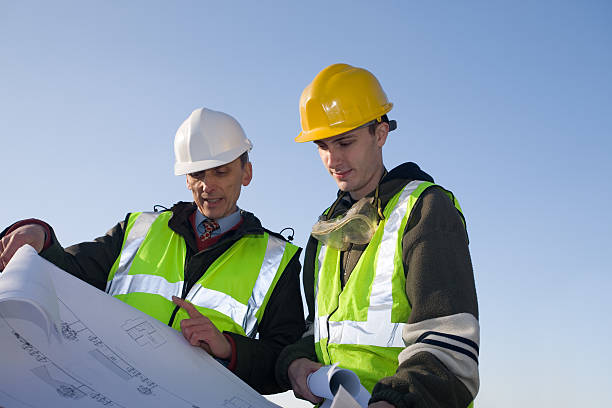 Architect / Surveyor and Builder -- Site Inspection - XLarge stock photo