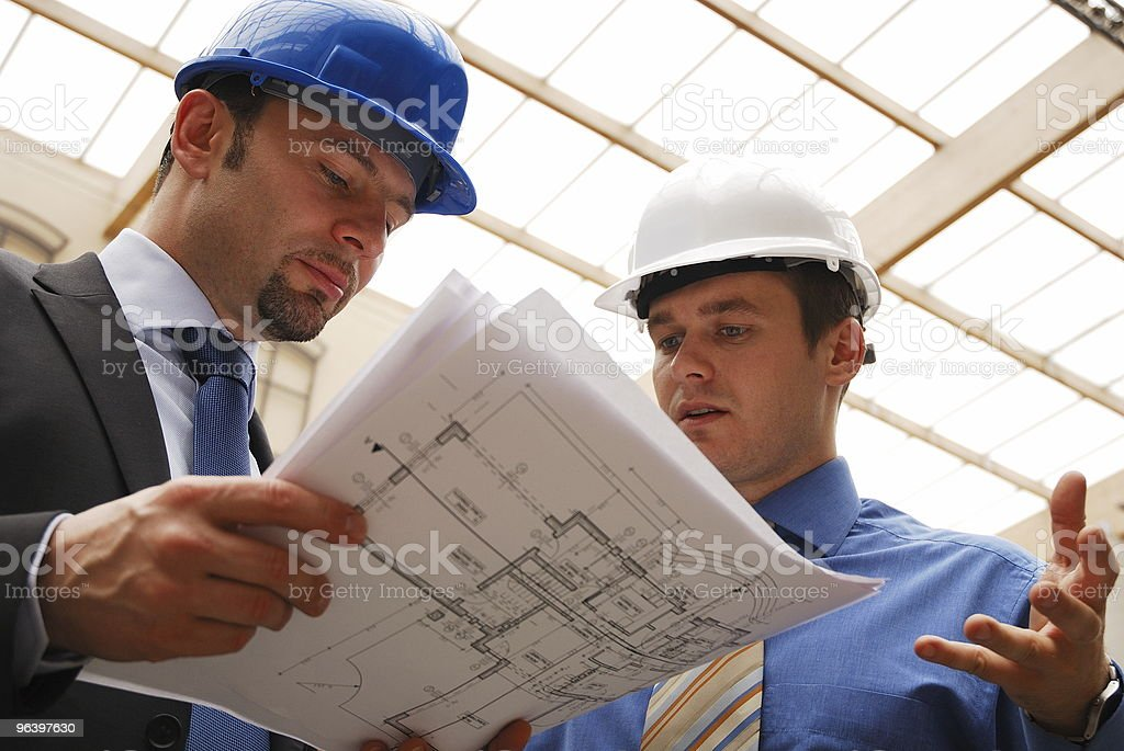 architect talking to investor over the blueprints - Royalty-free Adult Stock Photo