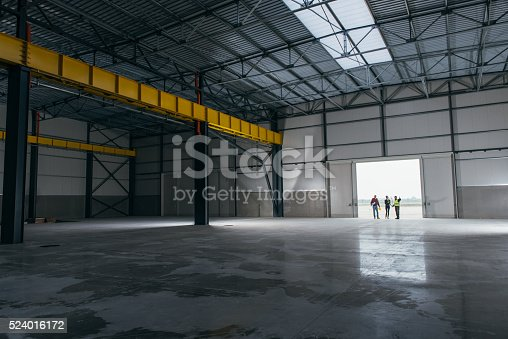 istock Architect team At Work Site With Blueprints 524016172