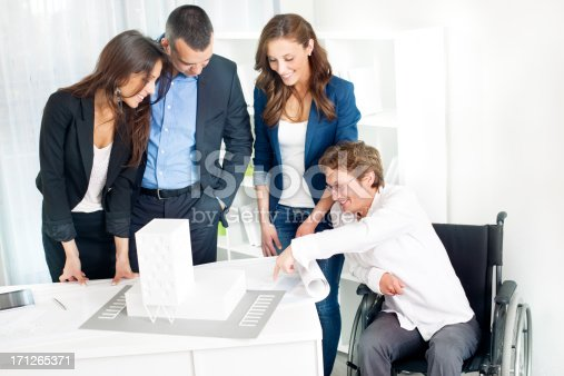 istock Architect Team with disabled woman in cheelchair having Meeting. 171265371