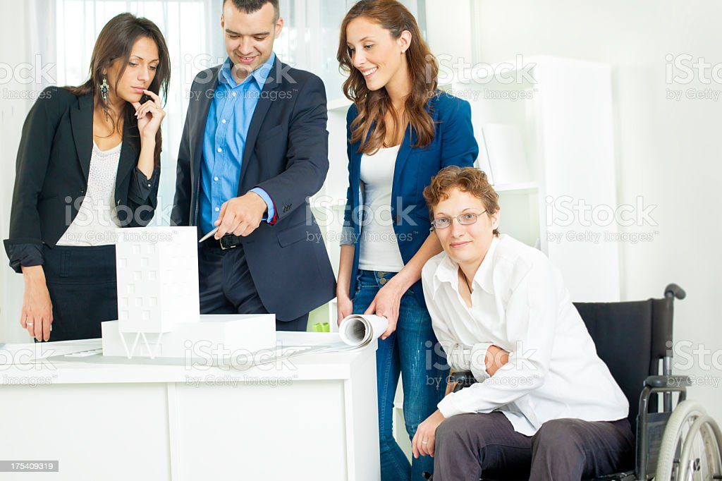 Architect Team with disabled woman in cheelchair having Meeting. royalty-free stock photo