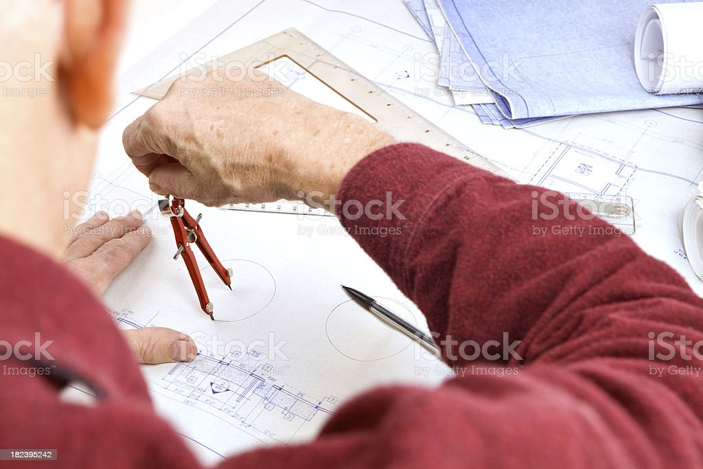 Architect Using a Compass Drawing Circle on Blueprint royalty-free stock photo