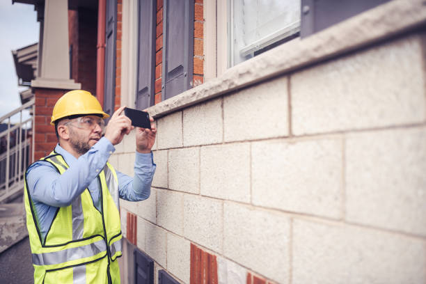 Architect using his phone to take photos of the construction deficiencies . stock photo