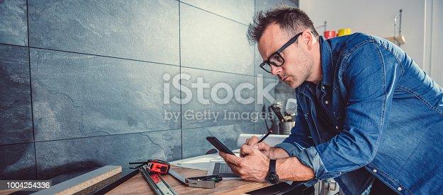 istock Architect using smart phone 1004254336