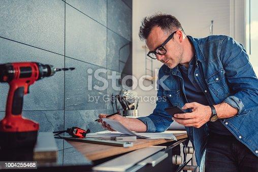 istock Architect using smart phone 1004255468