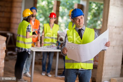 516607254istockphoto Architect visualizing future building 516556120