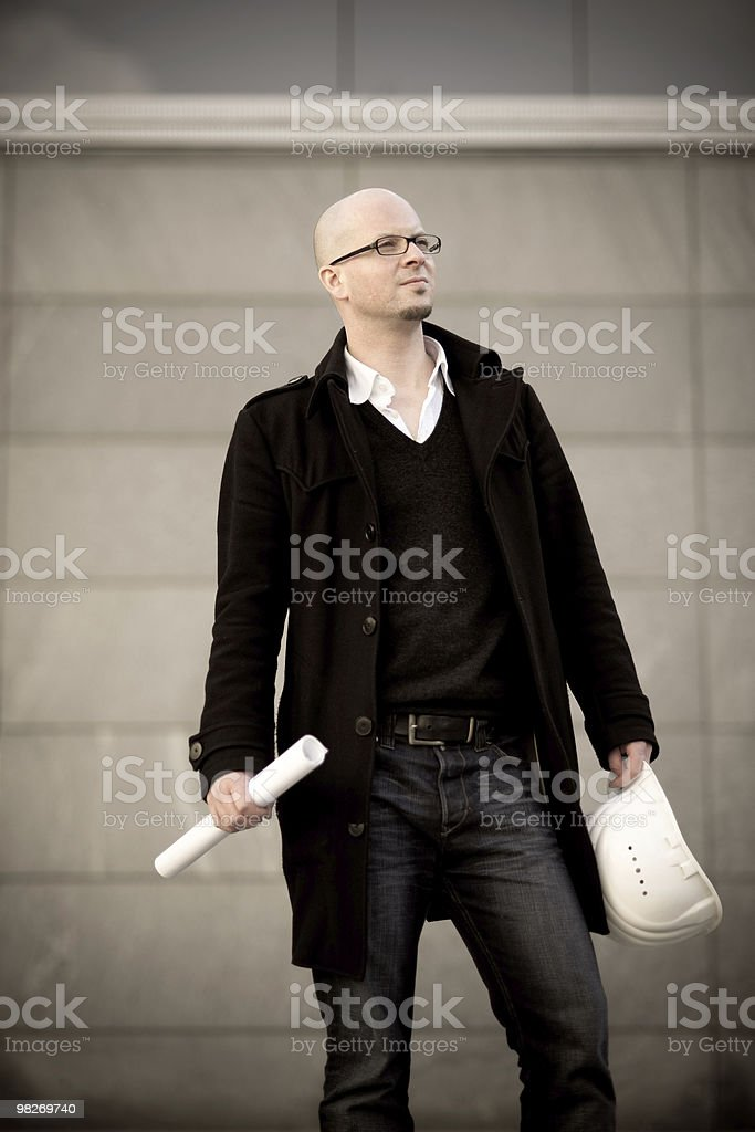 Architect with helmet and plan royalty-free stock photo