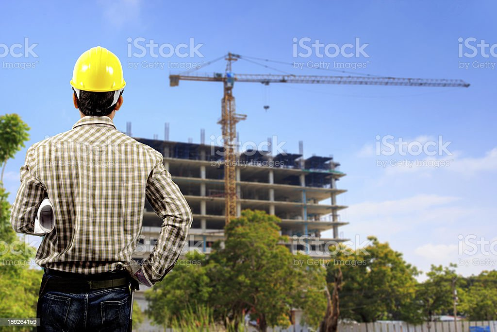 architect with holding blueprints looking construction royalty-free stock photo