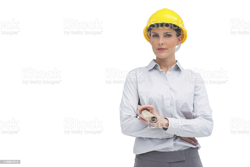 Architect with yellow helmet and rolled up plan royalty-free stock photo