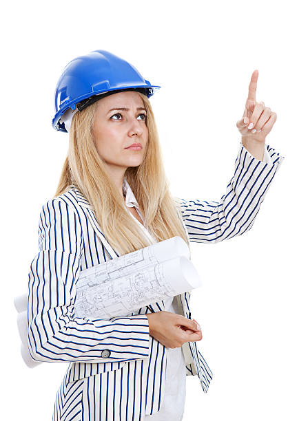Architect woman pointing up stock photo