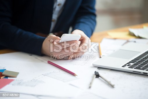 istock Architect woman using phone, close-up 524148262