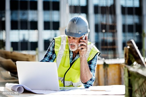 istock Architect working at construction site 552721783