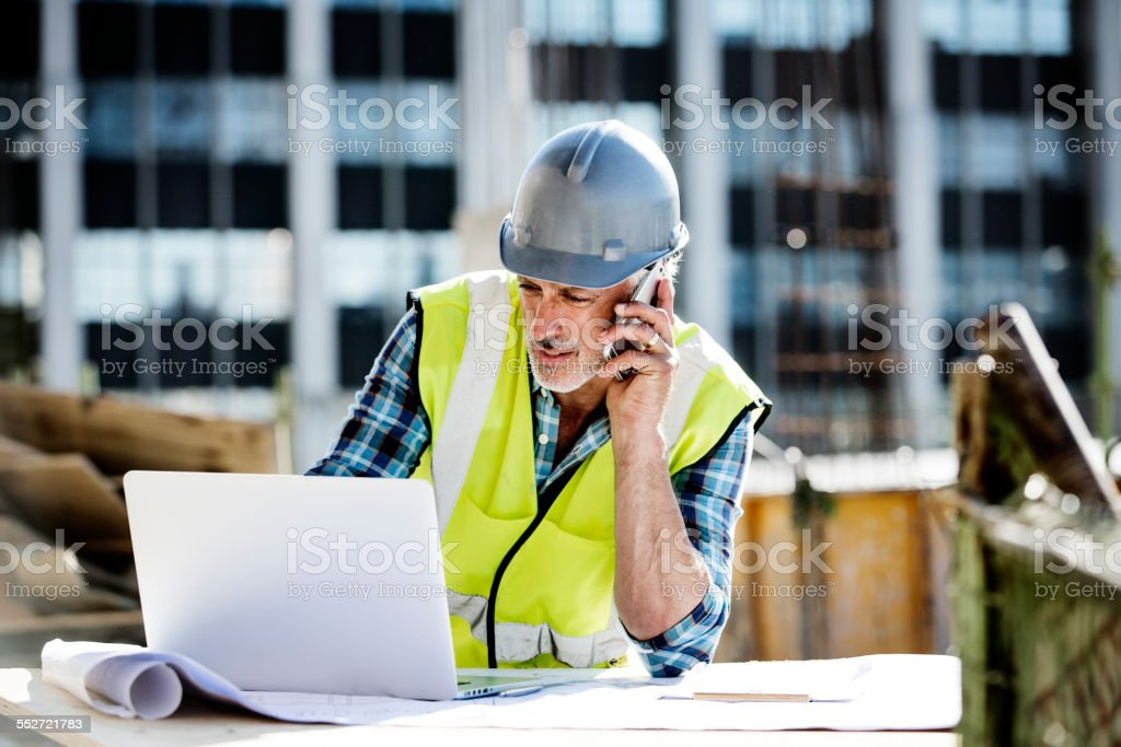 Architect working at construction site stock photo