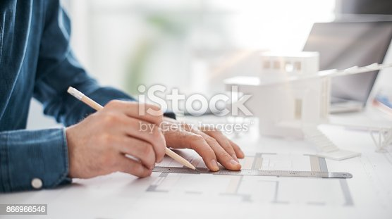 istock Architect working in his office 866966546