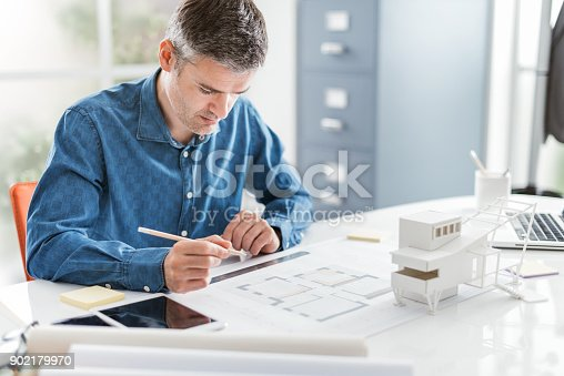 istock Architect working in his office 902179970