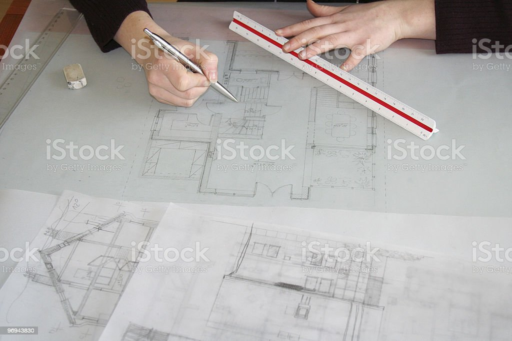 architect working on a blueprint royalty-free stock photo