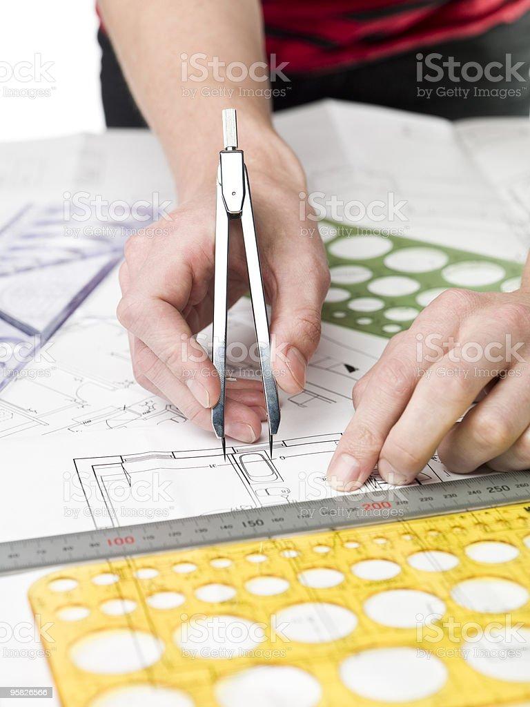 Architect working on a bluprint royalty-free stock photo