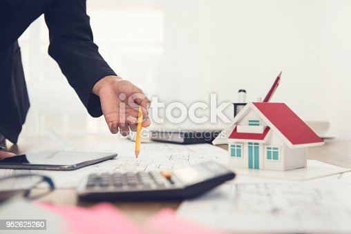 915688450 istock photo Architect working on a  house model 952625260