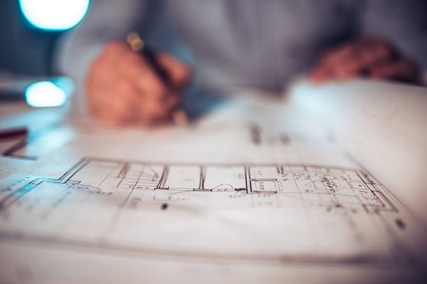 Architect working on a new house project. stock photo