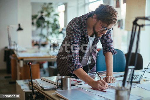 istock Architect working on a project 873055518