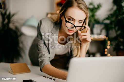 1031394390istockphoto Architect working on a project 892694416