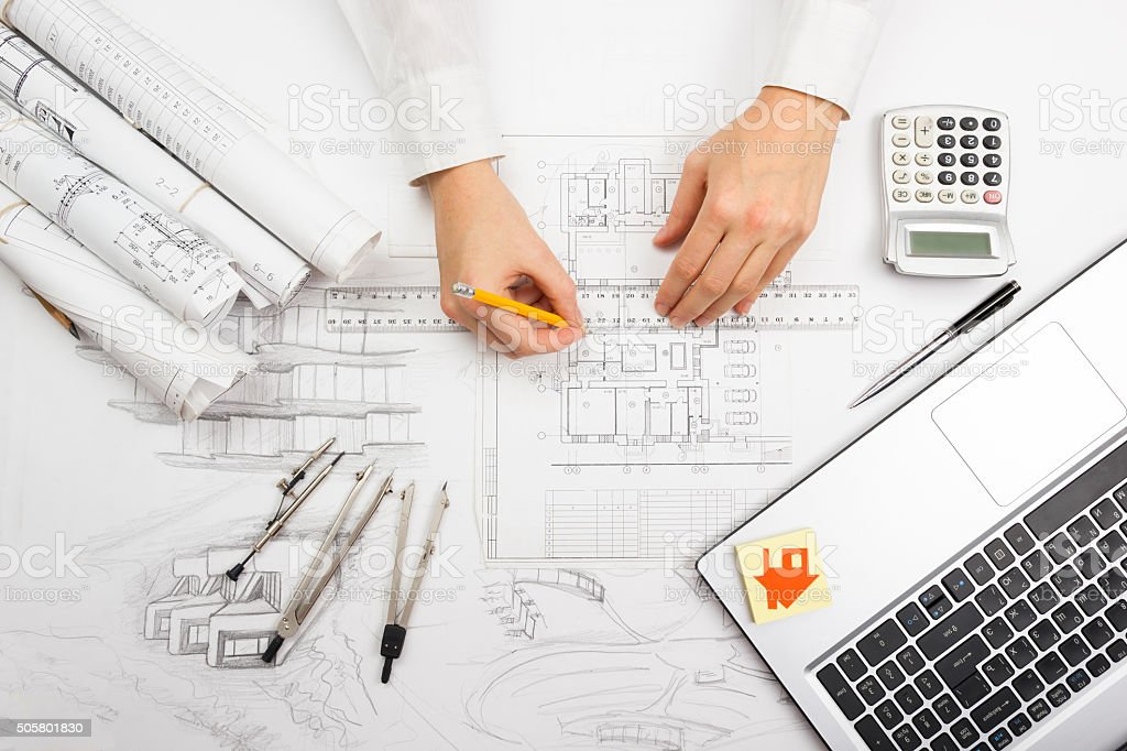 Architect working on blueprint architects workplace architectural architect working on blueprint architects workplace architectural project blueprints royalty free stock malvernweather Image collections