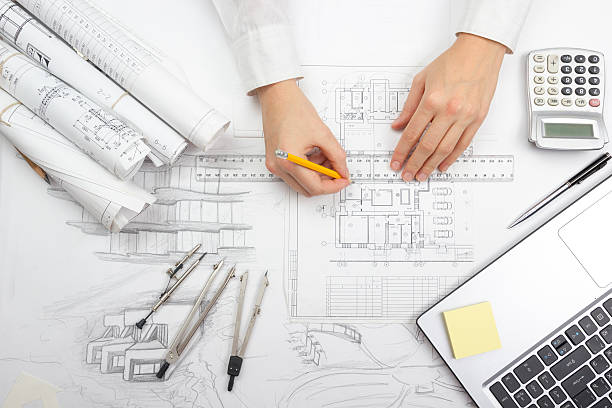 Architect working on blueprint. Architects workplace - architectural project, blueprints​​​ foto