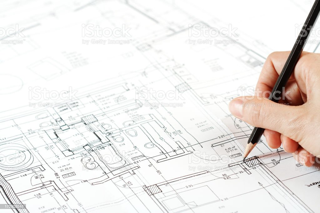 Architect working on blueprint projects royalty-free stock photo